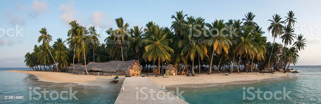Caribbean island with bamboo huts stock photo