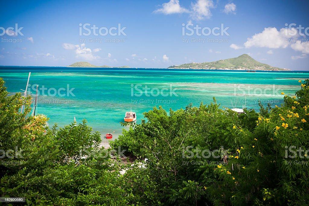 caribbean lagoon with boats stock photo