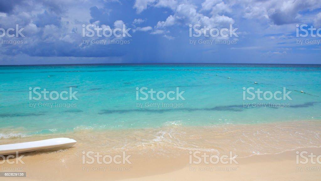 Caribbean sea and surfboard stock photo