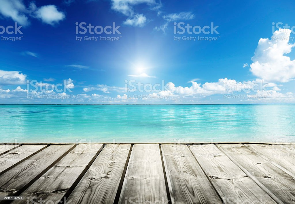 Caribbean sea and wooden platform stock photo