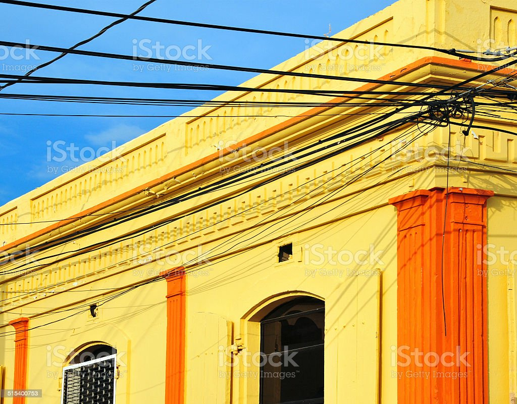 Caribbean street corner with cables stock photo