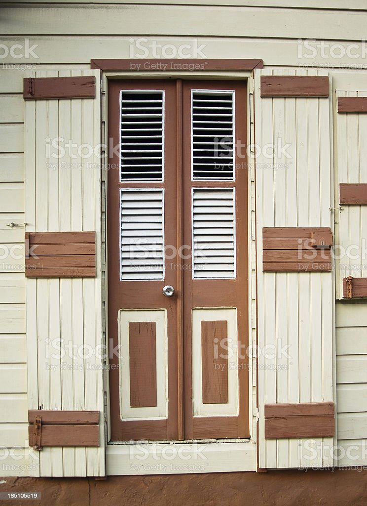 caribbean styled brown door of house stock photo