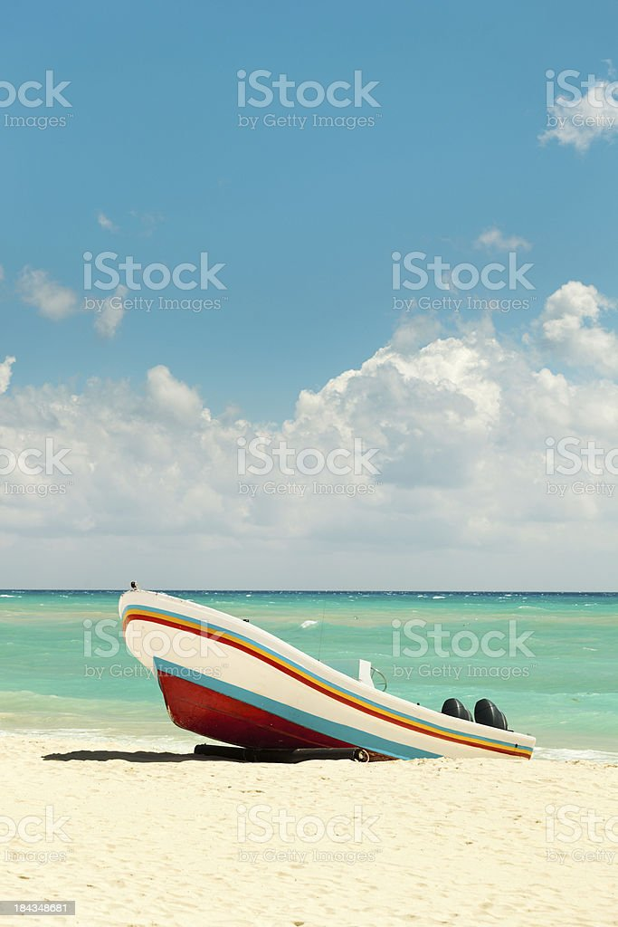 Caribbean Tropical Vacation Beach with Fishing Boat Vt royalty-free stock photo