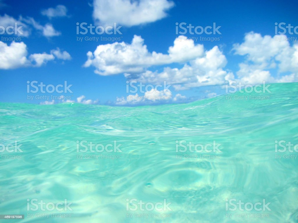 Caribbean water and sky with clouds stock photo