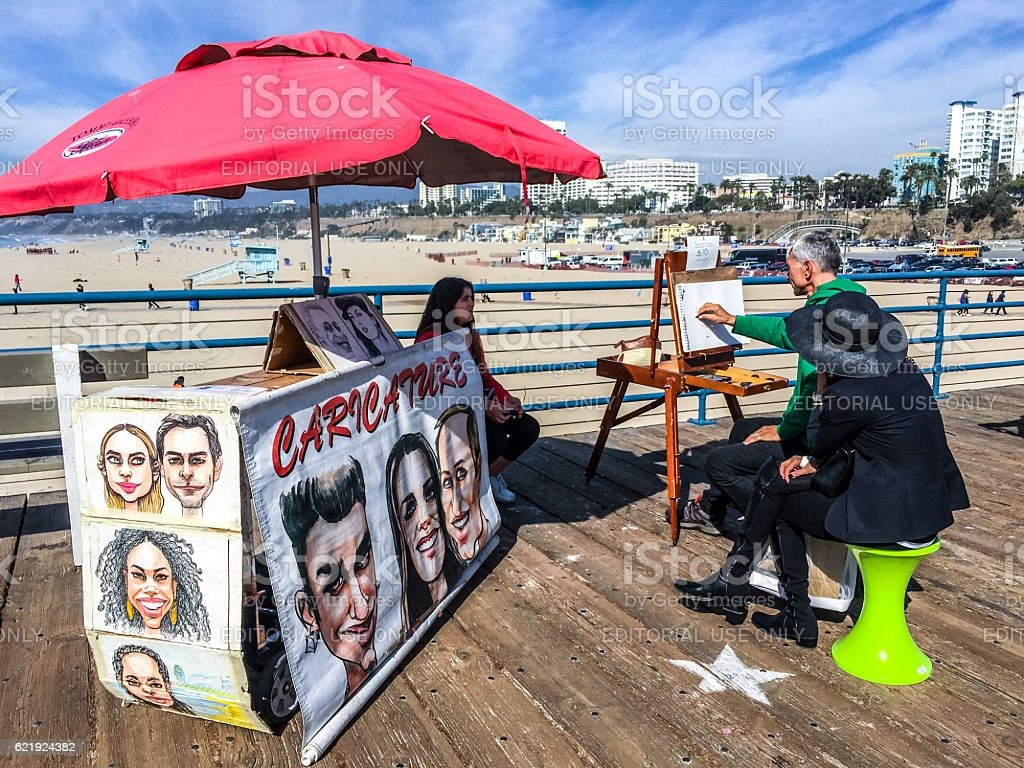Caricature painting for tourists on Santa Monica Pier, USA stock photo