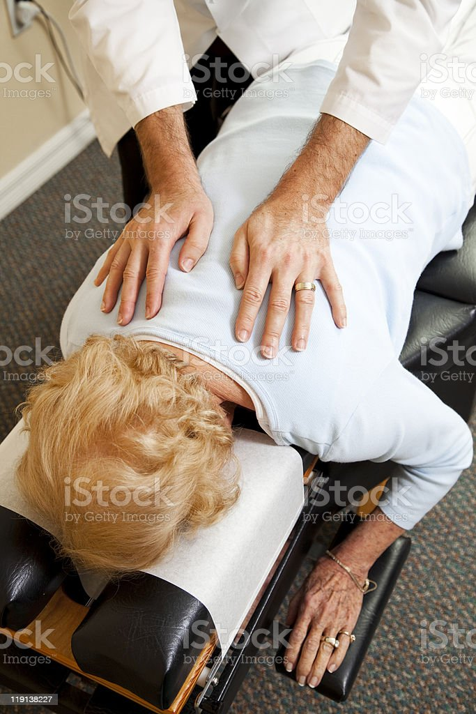 Caring Chiropractic Treatment royalty-free stock photo