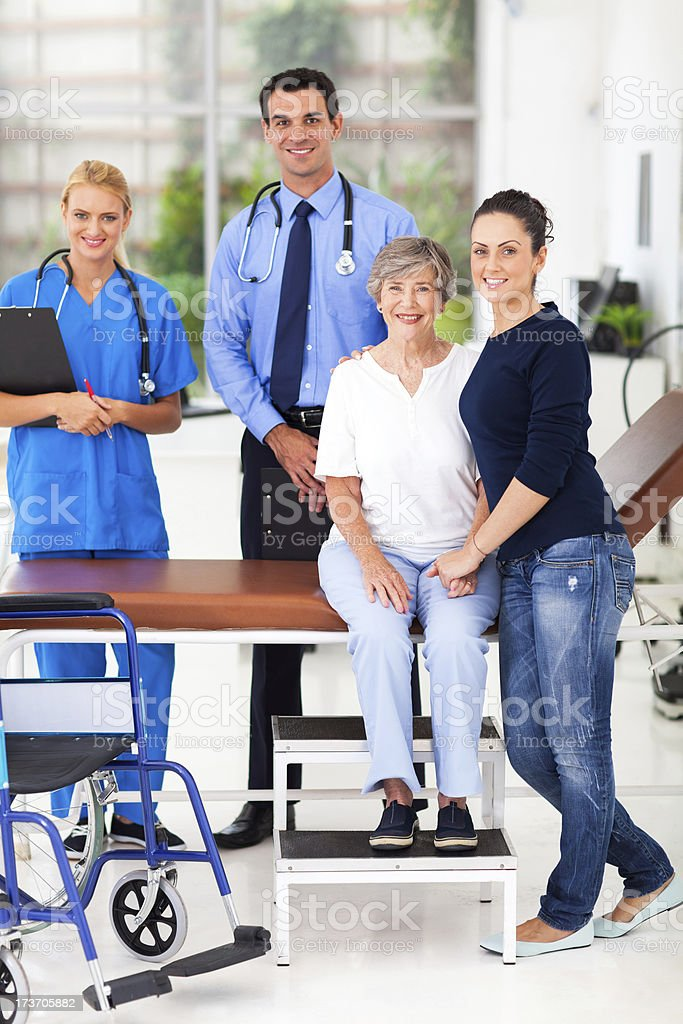 caring daughter taking senior mother for checkup royalty-free stock photo