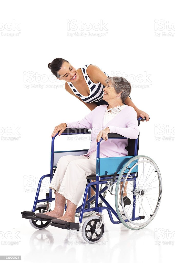 caring daughter talking to disabled senior mother royalty-free stock photo