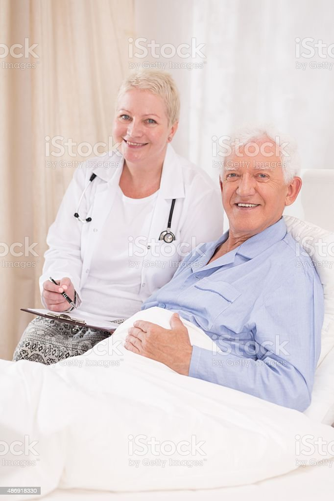 Caring doctor and her patient stock photo