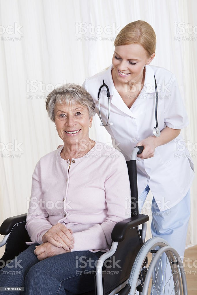 Caring Doctor Helping Handicapped Patient royalty-free stock photo