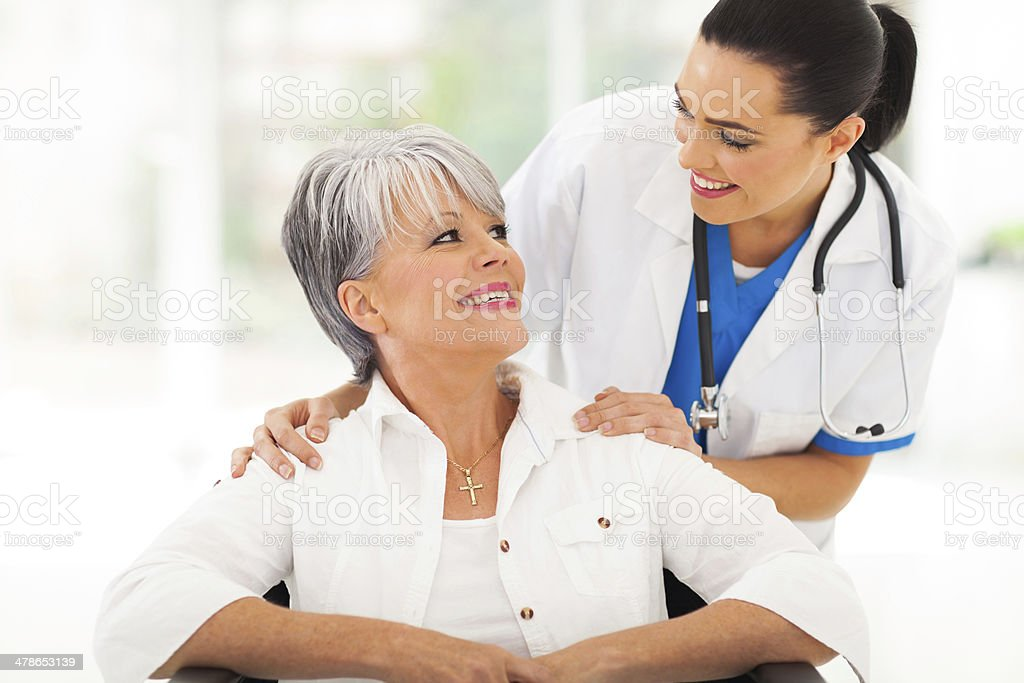 caring doctor with senior patient stock photo