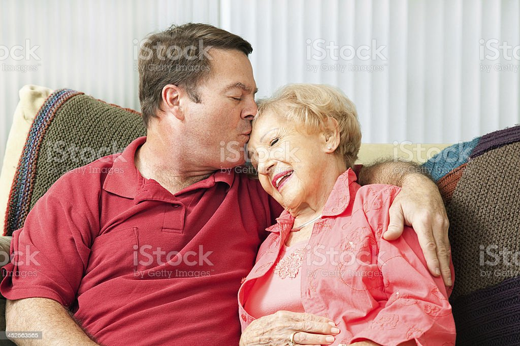 Caring For Elderly Mother stock photo