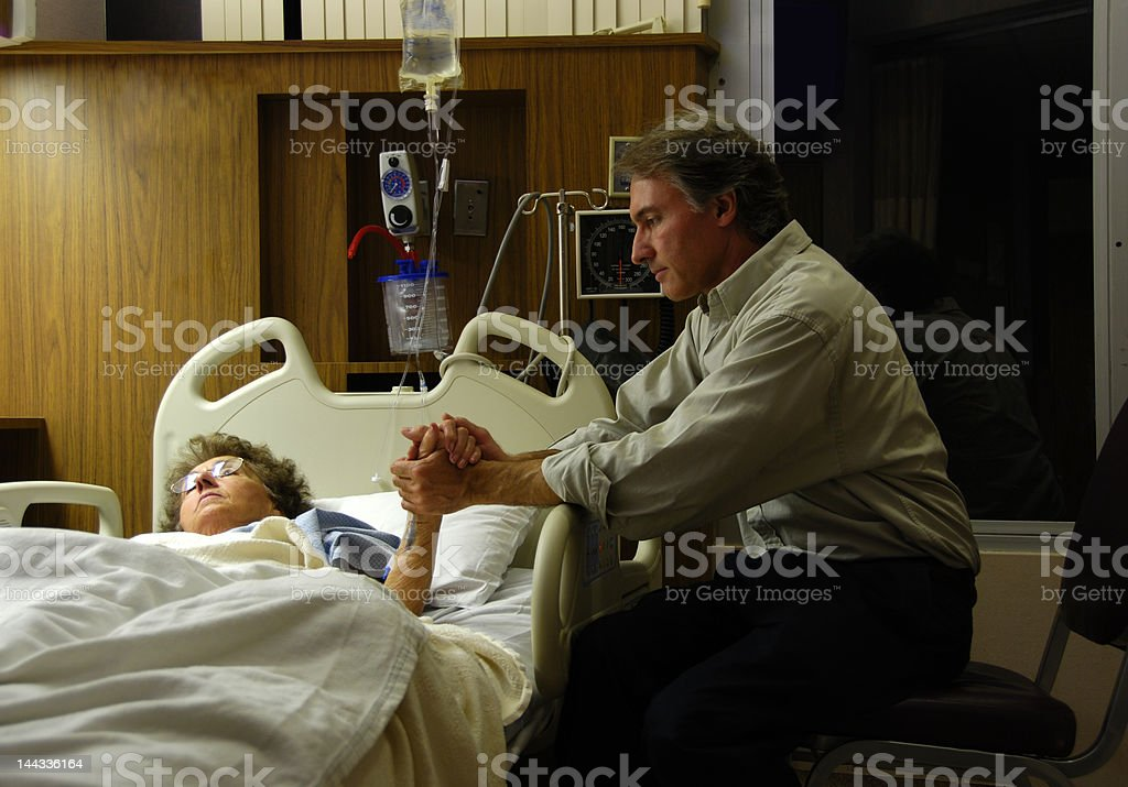 Caring Hands in Hospital stock photo