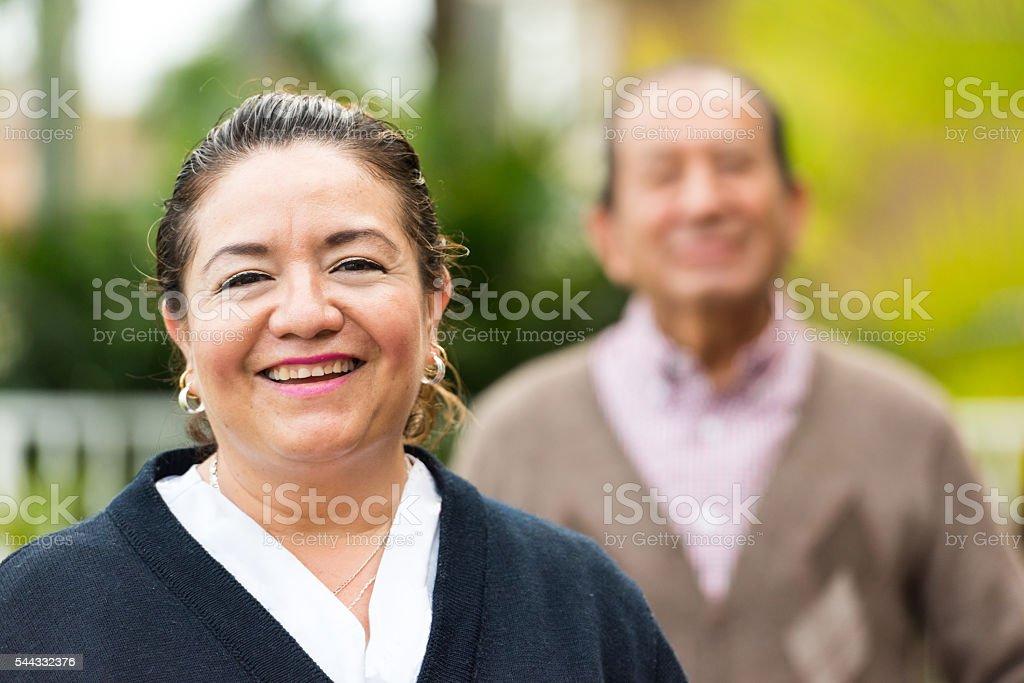 Caring, hispanic nurse and elderly senior patient in nursing home stock photo