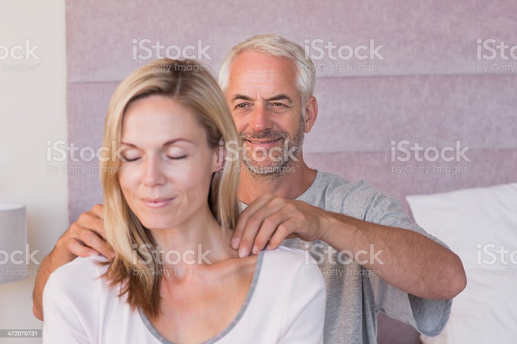 Caring man giving massage to his wife royalty-free stock photo