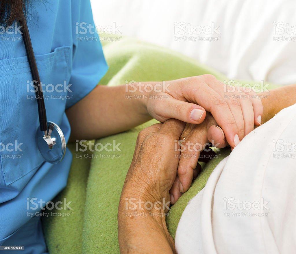 Caring Nurse Holding Hands stock photo