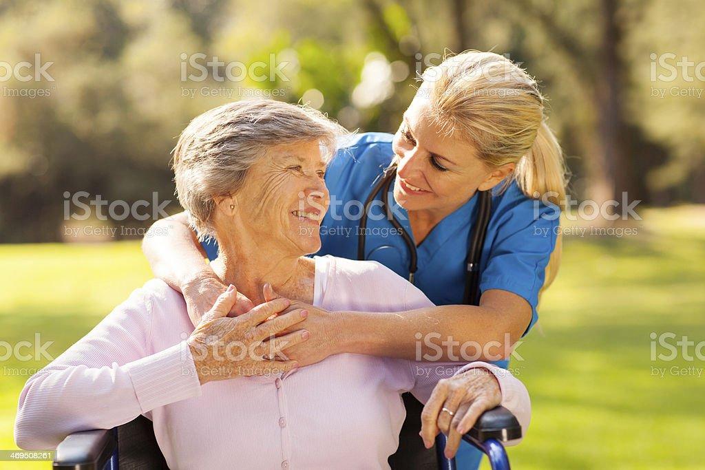 caring nurse with senior patient stock photo