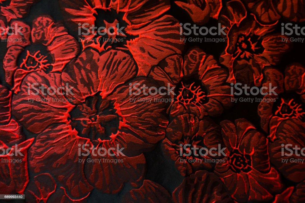 Carmine red flowers pattern on black jacquard fabric stock photo