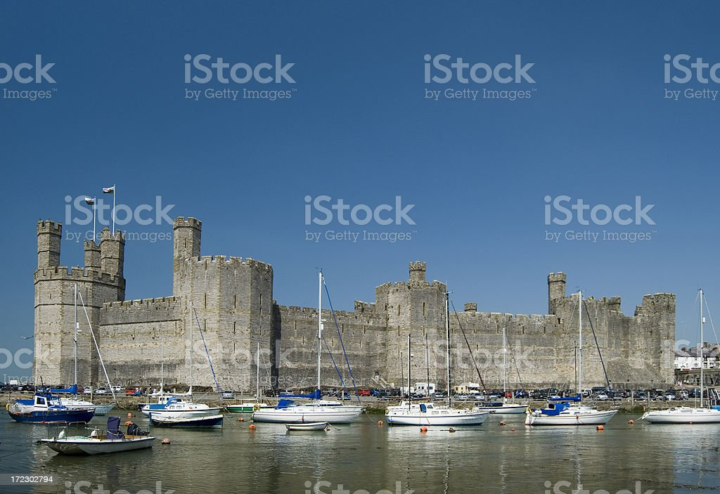 Carnarvon Castle and Harbour in Wales UK stock photo