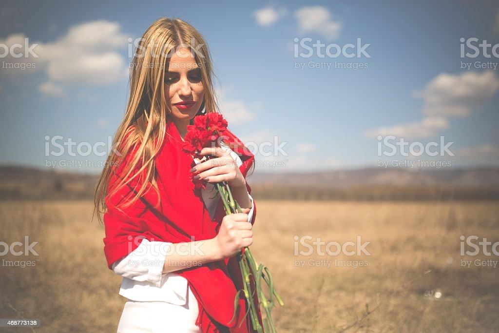 Carnations  and beautiful woman stock photo