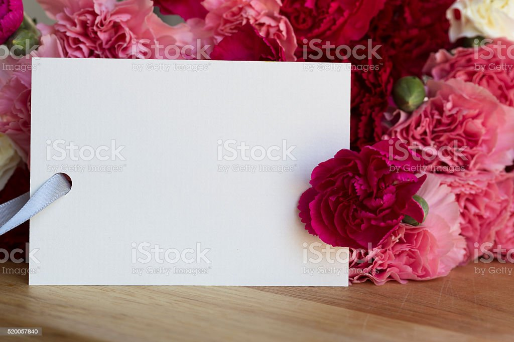 Carnations and Card for Greeting stock photo