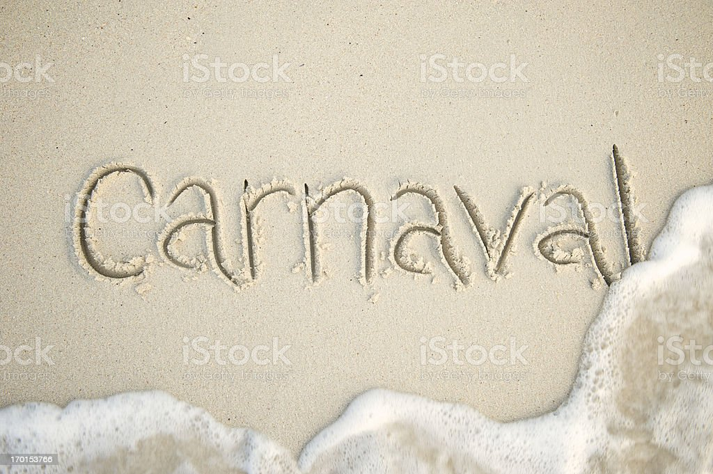 Carnaval Message in Clean Sand with Foamy Wave royalty-free stock photo
