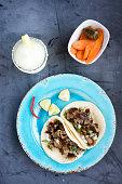 Carnitas tacos and a Margarita