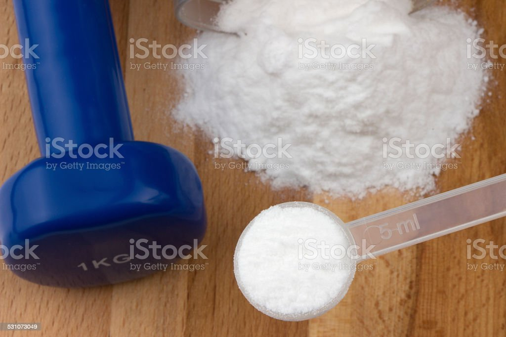L carnitine and dumbbell stock photo