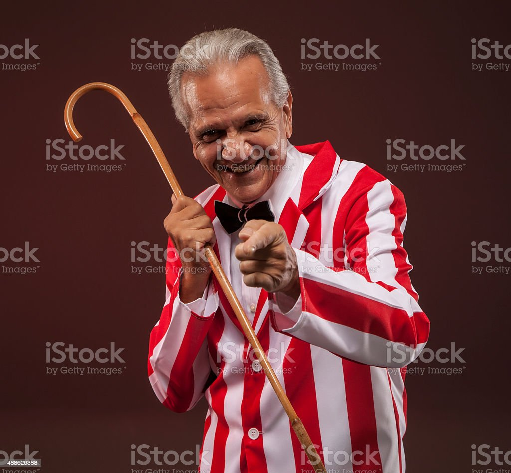 Carnival barker pointing and smiling. stock photo