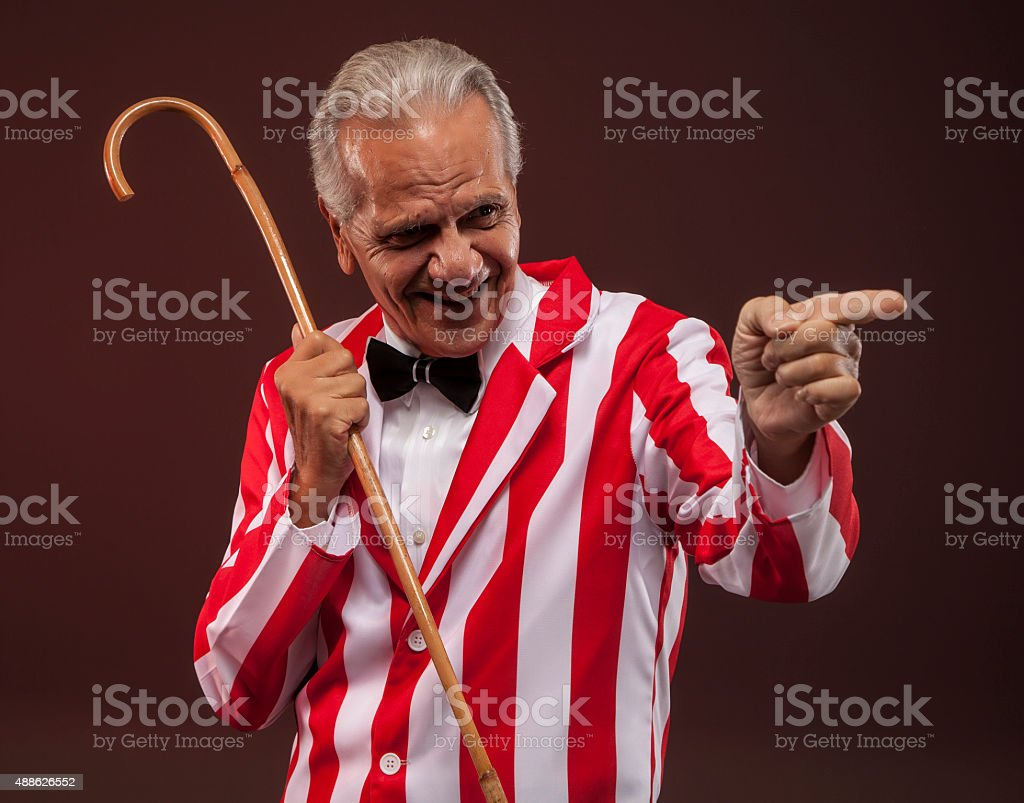 Carnival barker pointing to the side. stock photo