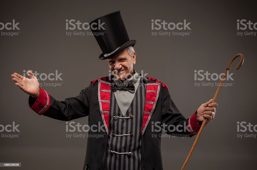 Carnival Barker with a cane. stock photo