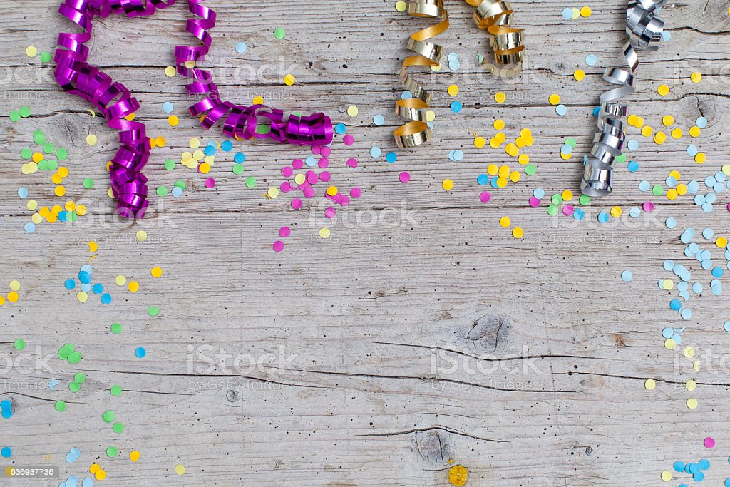 carnival confetti on wood background stock photo