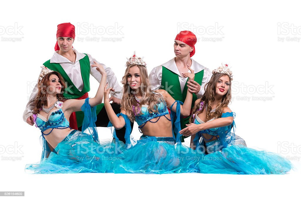 Carnival dancer team dressed as mermaids and pirates.  Isolated on stock photo