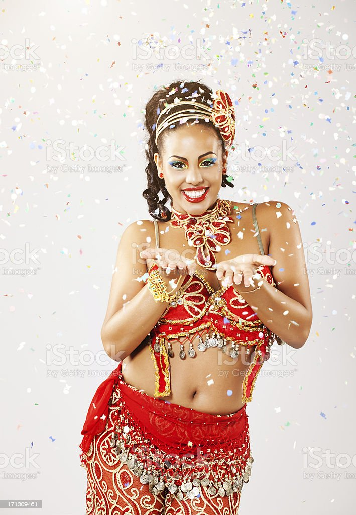 carnival dancer throwing confetti royalty-free stock photo