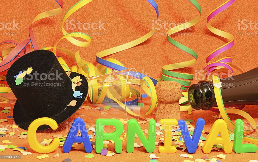 Carnival decoration with party hat and champagne bottle royalty-free stock photo