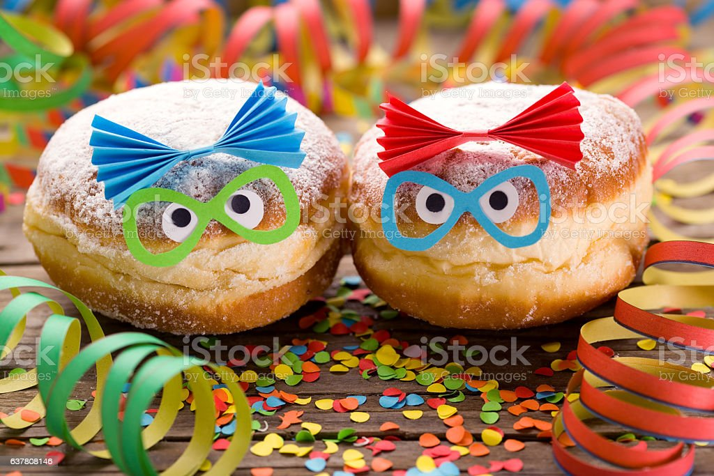Carnival doughnuts with funny faces stock photo