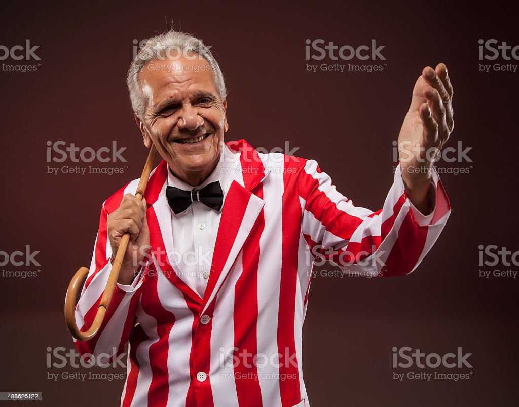 Carnival entertainer smiling at the audience. stock photo