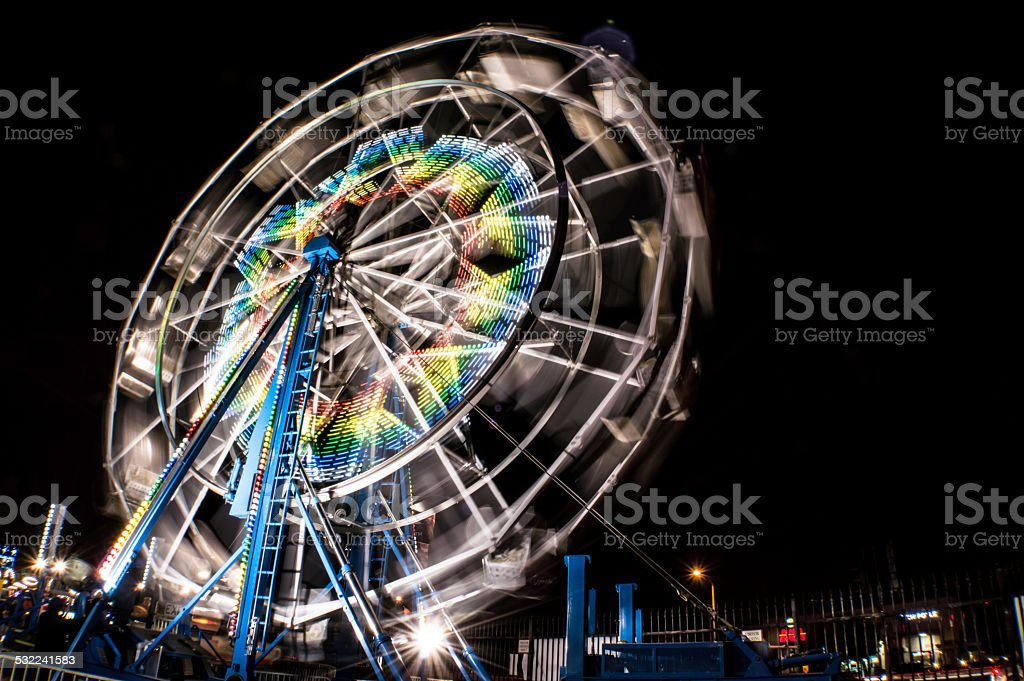Carnival ferris wheel at night stock photo