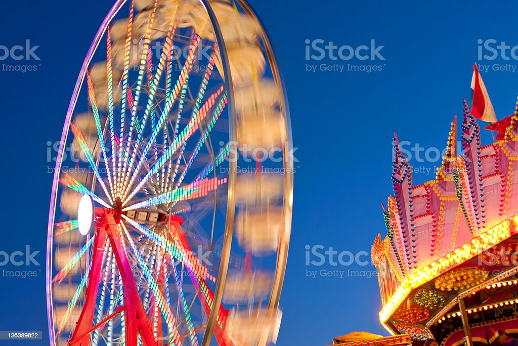 Carnival Ferris Wheel Lights Blur With Motion At Night stock photo