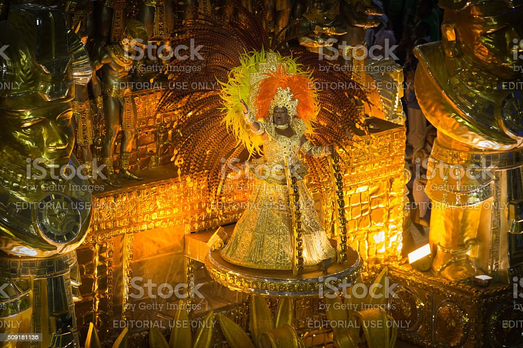 Carnival floatee dressed in gold royalty-free stock photo