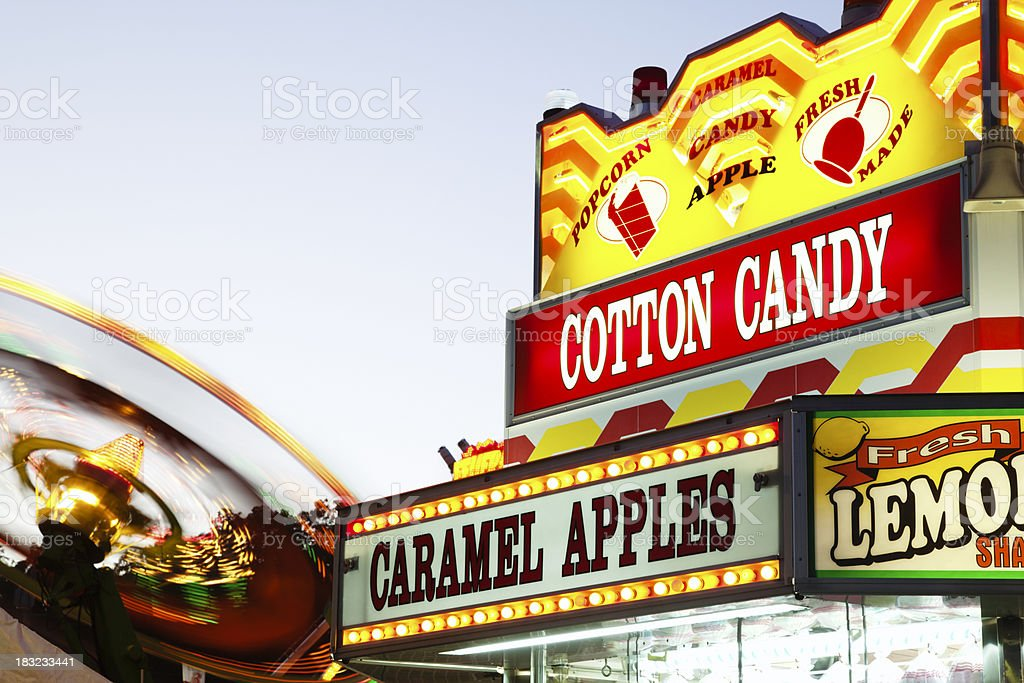 Carnival Food Concession Stand Sign and Amusement Park Ride stock photo