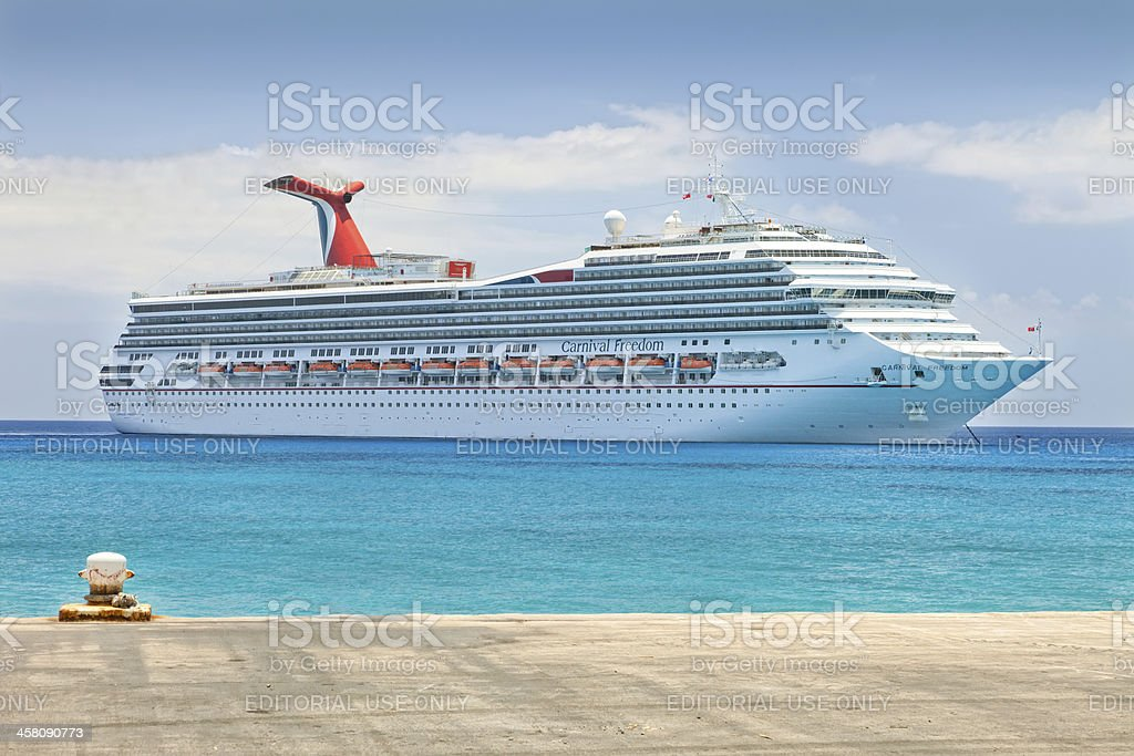 Carnival Freedom Anchored in the Cayman Islands stock photo