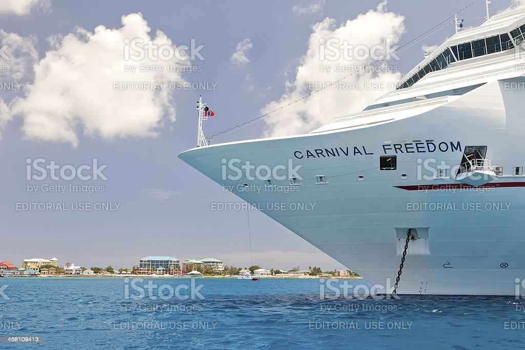 Carnival Freedom Anchored off shore at Grand Cayman stock photo