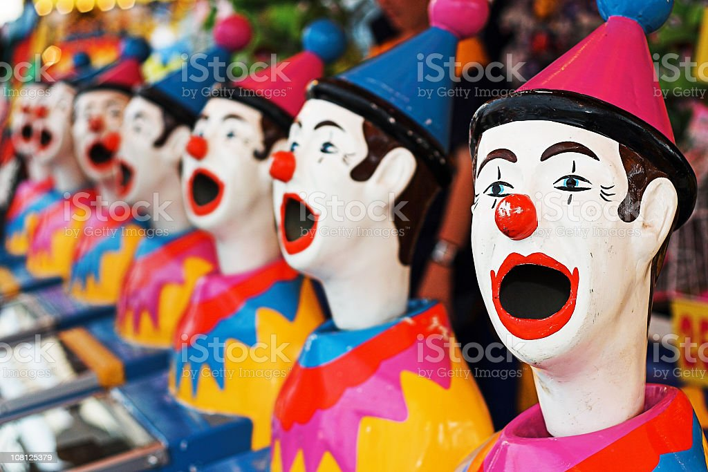 Carnival game featuring colorful open mouthed clown heads stock photo
