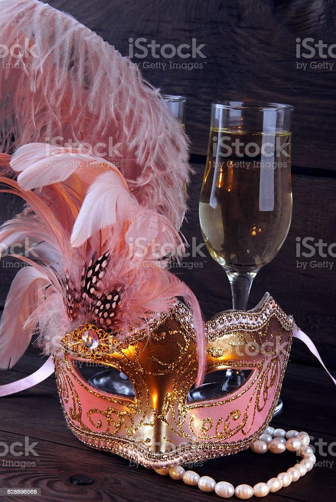 Carnival mask and glass of wine stock photo