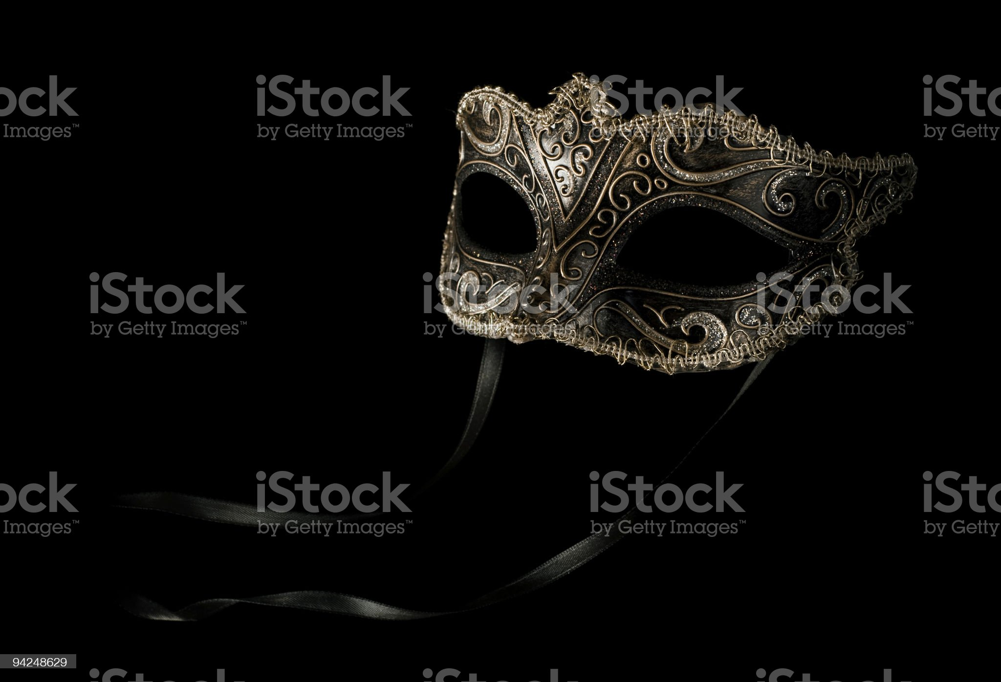 carnival mask isolated on black with stripe royalty-free stock photo
