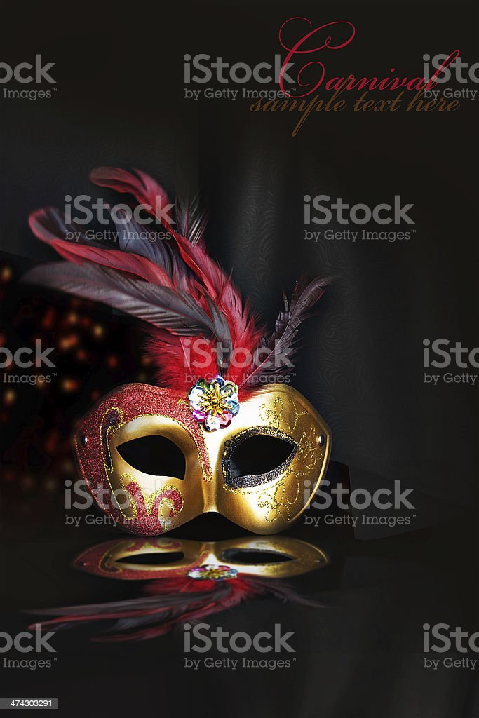 Carnival mask on black silk background stock photo