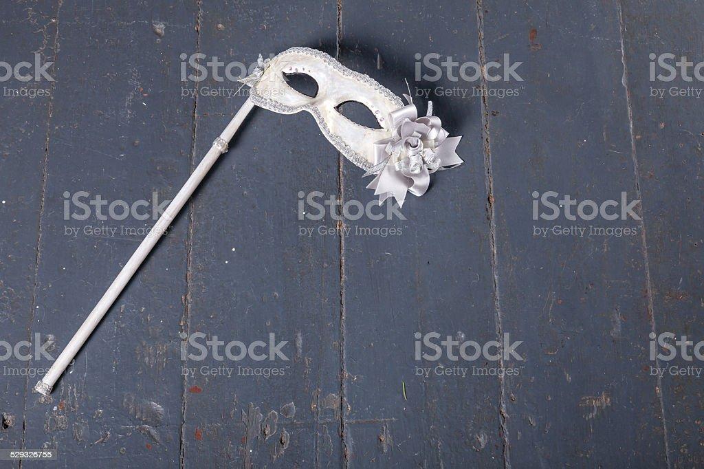 Carnival mask on dark wood background stock photo