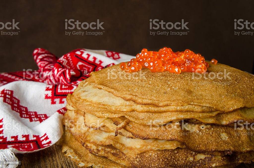 Carnival. Pancakes with red caviar. Russian style. stock photo