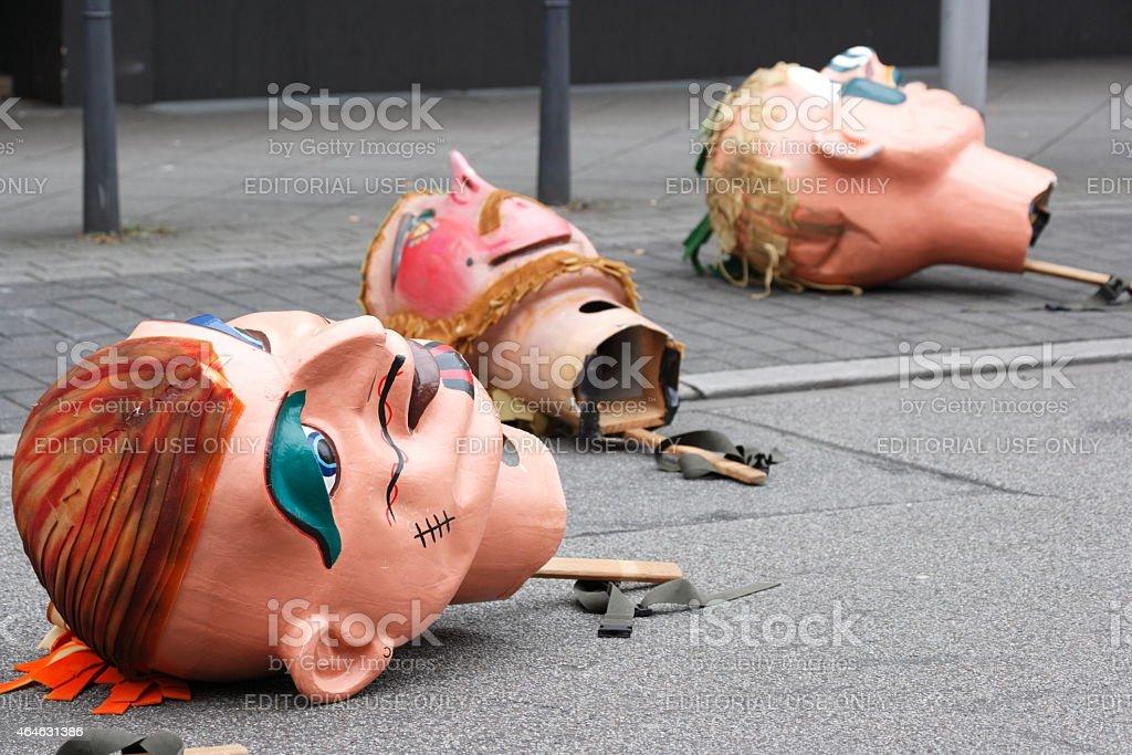 Carnival parade, three oversized masks on street stock photo